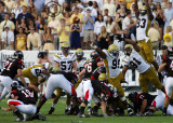 Jackets defense attempts to block a field goal by Bulldogs K Ryan Gates