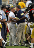 Jackets Head Coach Paul Johnson meets at midfield after the game with Gardner-Webb Head Coach Steve Patton