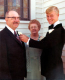 Here we see, David Arthur Robinson pinning a corsage onto his father's lapel, on his wedding day. Shown above, left to right we see, Harold Everette Robinson, his wife, Lucille Alena [Mattson] Robinson, and their son, David Arthur Robinson, on the day of his wedding to, Lois Marie St. Clair.