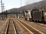 A hopper train leaving as seen from the last car.jpg