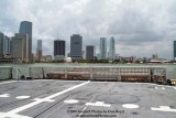 A partial view of the helo deck onboard the USCGC BERTHOLF (WMSL 750) with downtown Miami in the background, photo #0535