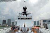 Looking aft from the bow onboard the USCGC BERTHOLF (WMSL 750) with downtown Miami in the background, photo #0540