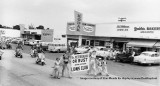 1950's - Opa-locka Arabian Nights Parade with a Value Market, Ernie Skog's Camera Store and Grables Bakery in the background