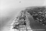 1950's - aerial view of Miami Beach depicting Collins Avenue, the Edec Roc and Fontainebleau Hotels