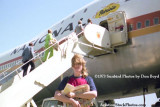 1973 - windblown stair truck boarding National Airlines B747-135 N77772 Patricia at LAX