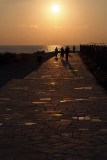 Joggers on Pafos Coastal Walk at Sunset