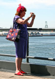 Red Hat Lady Capturing the Scene at Pier 17