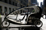 Empty Pedicab with Washington Place in the Background
