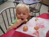 Conner eating his first do-nut at DFCI