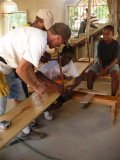 putting the metal legs on the pew boards  (total of 60 were made) each took 2 boards and 3 legs