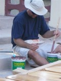 Eric stirring paint