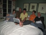 all of the family in one bed looking at today pictures of the wedding