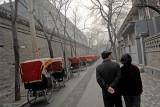 Couple walking a Beijing Hutong