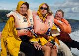 Girls on speedboat