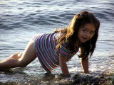 Cute little girl looking for shells