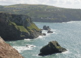 looking towards St Agnes from Trevellas Porth - birdy cove behind natural rock arch