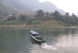 Boat crossing Nam Ou; guesthouses on riverbank opposite