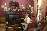 Jim, with his own Sherlock Holmes pipe, in Mr. Holmes study at 221B Baker St