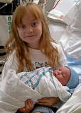 KATIE, WITH HER NEW LITTLE BROTHER