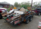 ONE OF THE MANY TRAILER LOADS HEADED FOR THE DUMP