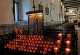 13.  Votive Candles in Chapel