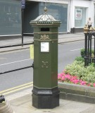 Ornate letter box near the castle gates.