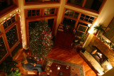 Happy Holidays - view of living room with gas fireplace  from loft above