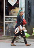 This woman carried the doll of a white child as she made her rounds about town