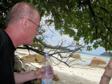 Seeking shelter for the burning sun at Anse Posession