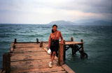 Dao posing on a dock in Na Trang