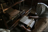 working at hand loom