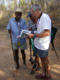 Tony showing local guides his field guide