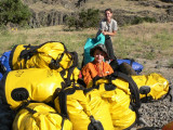 Cole sits amongst the yellow bags stuffed with our camping gear.