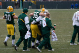 Mark Tauscher is helped off the field with a season-ending knee injury