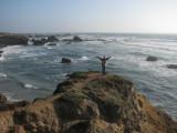 Linda climbs a rock