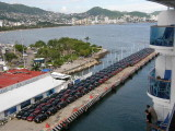 New cars were parked on two docks near our Acapulco pier.JPG