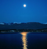 When the lake wears only the moonlight to seduce the mountains...
