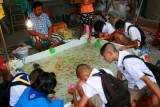 Children finding pet fish, Bangkok