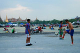 Locals play football near Grand Palace
