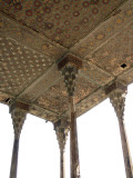 attractive wooden ceiling with intricate inlay work and exposed beams, reminiscent of the Chehel Sotun Palace