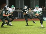 Evan Tripicco running with the ball on a quarterback keeper play which.....