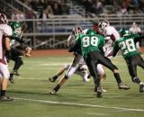 Dan Brhel and Chris Perry rushing the extra point kick after Sidney's second quarter touchdown