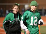 Meg Barbarino and Luke Daly during the halftime homecoming ceremony