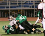 Roman Ismagilov and Lee Rogers tackling Sidney's Drew Fessenden