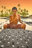 Boy playing konane (Hawaiian checker board game)