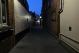 Narrow side-street before sunrise