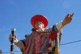 Statue of a man in traditional clothing at the entrance to the village of Pisaq