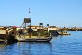 Large reed boat pulled up alongside the floating islands
