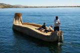 Reed boat with two kids