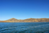 Puno in the distance across Lake Titicaca